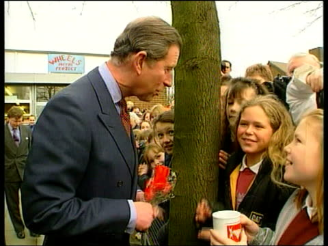 prince charles and camilla parker bowles first public appearance side gv charles holding bunch of flowers as given valentines mug by children in... - camilla duchess of cornwall stock videos and b-roll footage