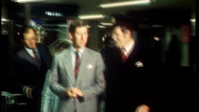 prince charles and camilla take the tube s30100607 / tx charles along through barrier at opening of jubilee line 'jubilee line 30 april 1979' sign... - charing cross stock videos and b-roll footage