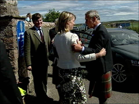 prince charles and camilla unveil memorial plaque for queen mother at canisbay church charles and camilla holding bunches of flowers departing in car... - memorial plaque stock videos and b-roll footage