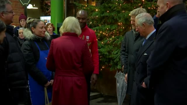 Prince Charles and Camilla visit Borough Market ENGLAND London Borough Market INT Camilla Duchess of Cornwall presented with flowers as she and...