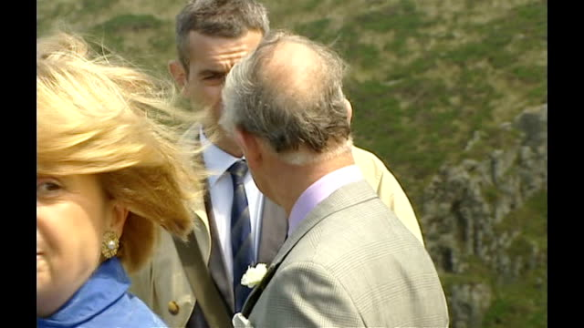 prince charles and camilla visit cornwall; charles and camilla on cliff top with english heritage employees / cliffs and sea at tintagel castle /... - hair back stock videos & royalty-free footage