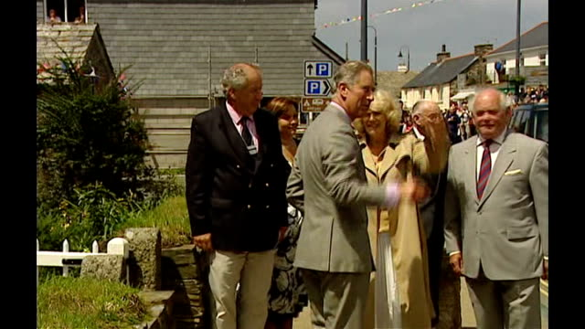prince charles and camilla visit cornwall royal car along down street lined with people / charles and camilla getting out of car then shaking hands... - pierced stock videos & royalty-free footage