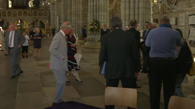 vidéos et rushes de prince charles and camilla visit exeter cathedral; england: devon: exeter: exeter cathedral: int various of camilla, duchess of cornwall, chatting... - michael morpurgo