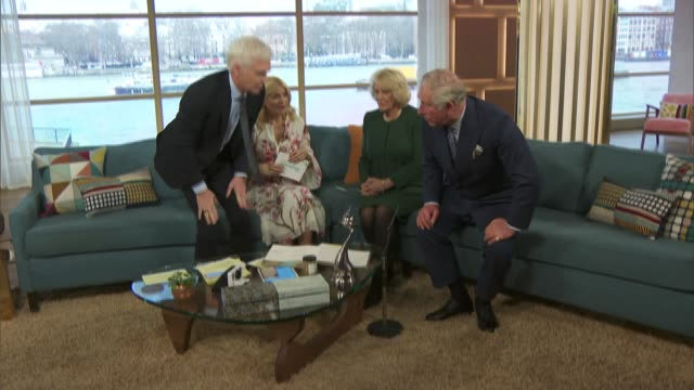 vídeos de stock, filmes e b-roll de prince charles and camilla visit itv studios pan tv camera to the sofa where phillip schofield holly willoughby camilla and prince charles are... - câmera de televisão