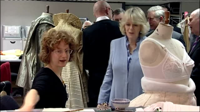 prince charles and camilla visit leeds; charles and camilla entering wardrobe department / charles and camilla looking at dummy wearing bra / costume... - bra stock videos & royalty-free footage