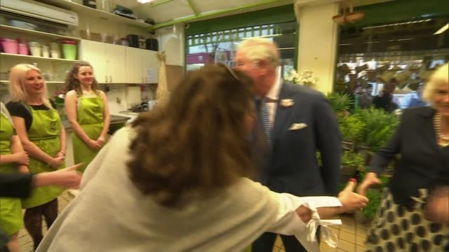prince charles and camilla visit oxford covered market; england: oxfordshire: oxford: int prince charles and camilla along in covered market chatting... - oxford england stock videos & royalty-free footage