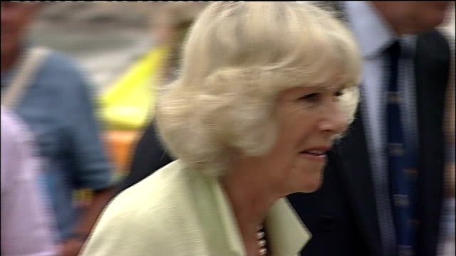 prince charles and camilla visit to the the isles of scilly; camilla along smiling - isles of scilly stock videos & royalty-free footage
