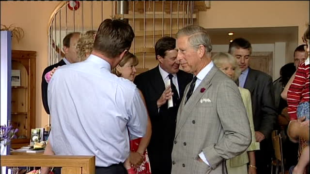 prince charles and camilla visit to the the isles of scilly; prince charles chatting with others ext prince charles and camilla greeting people then... - isles of scilly stock videos & royalty-free footage