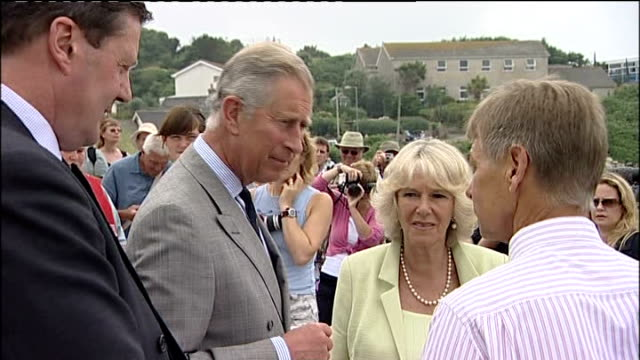 prince charles and camilla visit to the the isles of scilly; various of prince charles and camilla on beach chatting with locals sot - isles of scilly stock videos & royalty-free footage