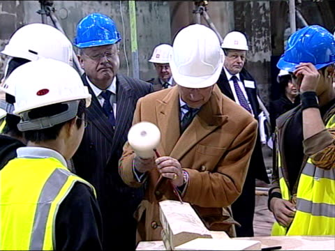 prince charles and camilla visits gorton monastery vars prince charles puts on safety glasses and has a go at stone carving using mallet and chisel - mallet hand tool stock videos and b-roll footage