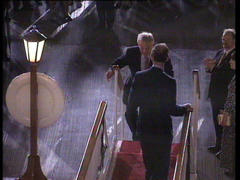 prince charles and chris patten board royal yacht britannia and wave to crowds hong kong handover; 30 jun 97 - anno 1997 video stock e b–roll