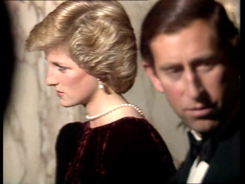 prince charles and diana attend 'back to the future' premiere; england: london: int tms princess diana r-l with officials to corridor cms prince... - premiere stock videos & royalty-free footage