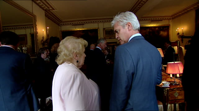 prince charles and duchess of cornwall reception for wrvs diamond champions; england: london: clarence house: int gvs of prince charles chatting with... - グロリア ハニフォード点の映像素材/bロール