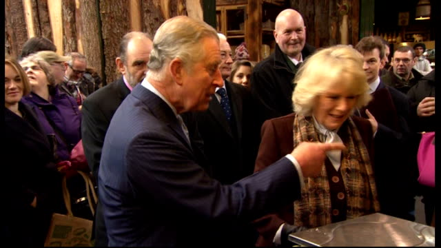Prince Charles and Duchess of Cornwall visit Borough Market More of Charles and Camilla meeting market people / Charles and Camilla at cheese stall /...