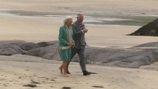prince charles and duchess of cornwall visit derrynane house; ireland: county kerry: derrynane house: prince charles and camilla walking along beach... - コーンウォール公爵夫人 カミラ点の映像素材/bロール
