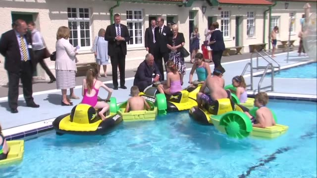 prince charles and duchess of cornwall visit pontypridd lido pontypridd lido / lido ponty national lido of wales gv of lido with peole swimmign in... - visit stock videos & royalty-free footage