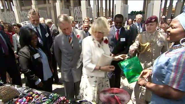 prince charles and duchess of cornwall visit south africa johannesberg soweto ext prince charles prince of wales and camilla duchess of cornwall... - headdress stock videos & royalty-free footage