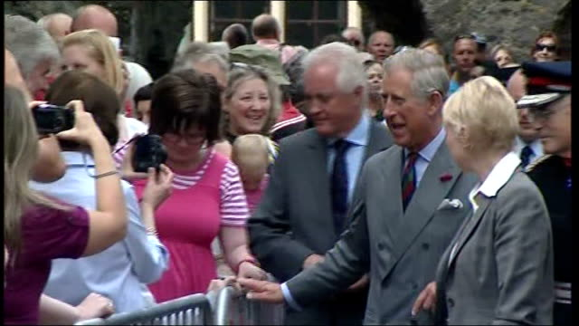 prince charles and duchess of cornwall visit tenby wales pembrokeshire tenby ext prince charles speaking to people and shaking hands on walkabout /... - pembrokeshire stock videos & royalty-free footage