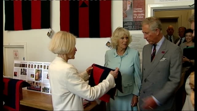 Prince Charles and Duchess of Cornwall visit Welsh Quilt Centre Prince Charles unveils plaque / Jen Jones presents Charles and Camilla with small...