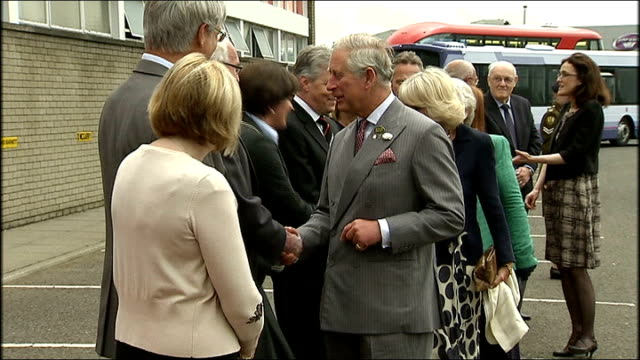 Prince Charles and Duchess of Cornwall visit Wrightbus bus manufacturer NORTHERN IRELAND County Antrim Ballymena Wrightbus EXT Cars arriving / Prince...