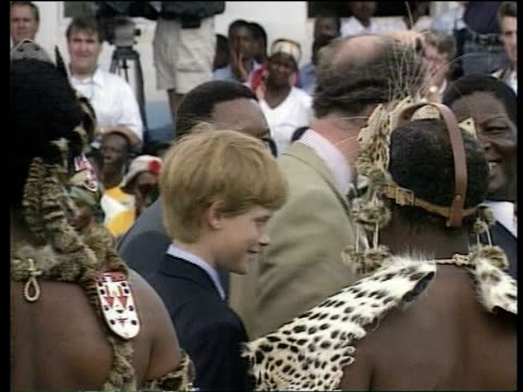vidéos et rushes de prince charles and harry tour een south africa dukuduku prince charles toasting arrival at zulu camp from a huge bowl of beer with prince harry... - prince philip