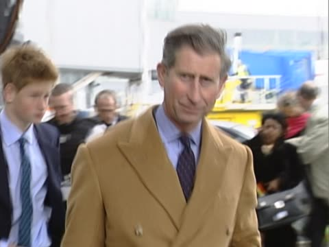 prince charles and his prince harry, aged 15,fly out of heathrow for swiss ski trip. formally dressed, the walk from car up to airport service steps... - skiurlaub stock-videos und b-roll-filmmaterial