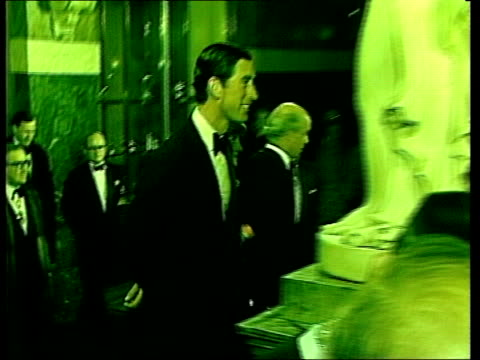 prince charles and lady diana at goldsmiths hall *distortion* ms both escorted up stairs ts ditto - 1981 stock-videos und b-roll-filmmaterial