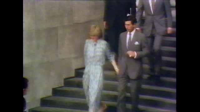 prince charles and lady diana exit st paul's cathedral after their wedding rehearsal and depart in a car through crowds of people; 1981. - probe stock-videos und b-roll-filmmaterial