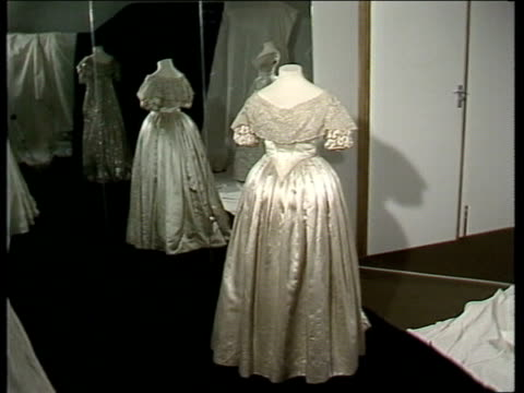 prince charles and lady diana royal wedding wedding dress england london museum pan dresses on display cs princess charlotte's dress tilt up and pull... - wedding dress stock videos & royalty-free footage