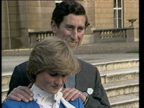 prince charles and lady diana spencer pose for press on steps of buckingham palace following announcement of their engagement london 24 feb 81 - prinz von wales stock-videos und b-roll-filmmaterial