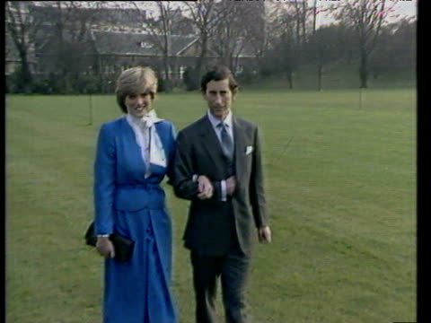 prince charles and lady diana walking together in buckingham palace grounds for press after announcement of their engagement; 24 feb 81 - チャールズ皇太子点の映像素材/bロール
