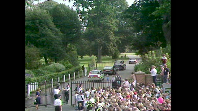 prince charles and lady diana wave to crowds as they drive into broadlands where they spent their wedding night before departing on their honeymoon;... - english culture stock videos & royalty-free footage