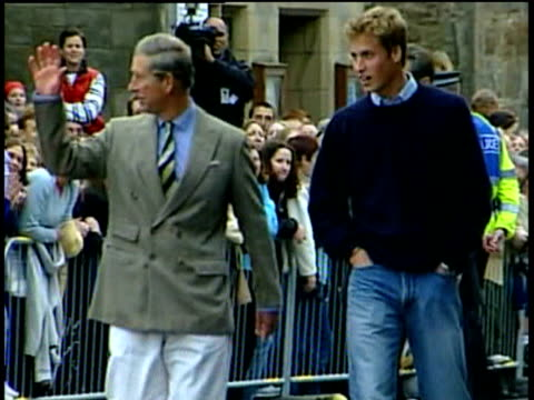 prince charles and prince william walk towards camera with well wishers in background on william's first day at university of st andrews 23 sep 01 - jeans stock videos & royalty-free footage
