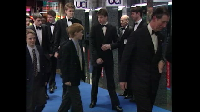 prince charles and princes william and harry arrive at premiere of spice girls movie spice world 1997 - 1997 stock-videos und b-roll-filmmaterial