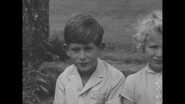 cu prince charles and princess anne pose for photos on grounds of balmoral castle / cu philip duke of edinburgh as he sits with the family - prince of wales stock videos & royalty-free footage