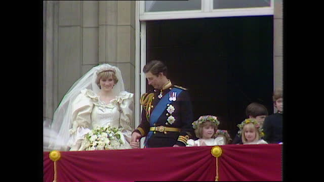 prince charles and princess diana are joined by page boys and bridesmaids on the buckingham palace balcony on the day of the royal wedding; 1981. - males stock videos & royalty-free footage
