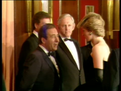 Prince Charles and Princess Diana greet cast and crew of 'Children of a Lesser God' at film premier