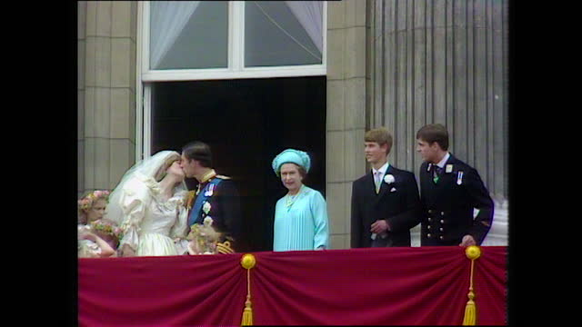 prince charles and princess diana kiss on the buckingham palace balcony as the members of the royal family smile and the crowd cheers on the day of... - balcony stock videos & royalty-free footage
