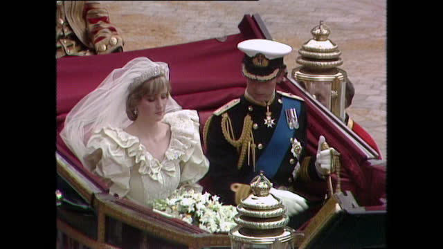prince charles and princess diana sit in the coach outside st paul's cathedral on the day of their wedding; 1981. - symbol stock videos & royalty-free footage