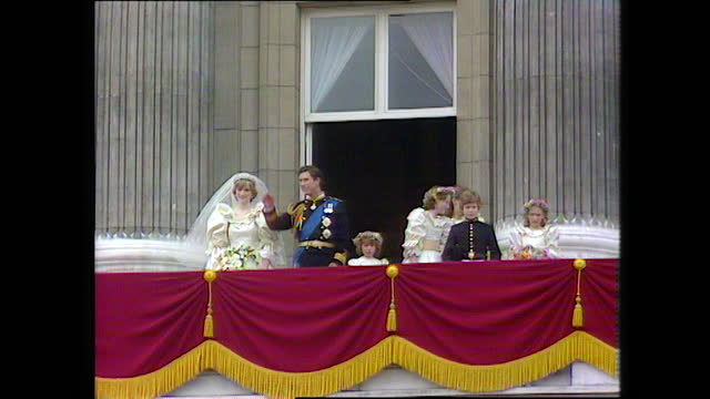 prince charles and princess diana stand on the buckingham palace balcony with the page boys and bridesmaids on the day of the royal wedding; 1981. - males stock videos & royalty-free footage