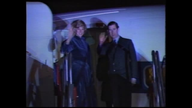 stockvideo's en b-roll-footage met prince charles and princess diana tarmac walk leaving for australia / bw photo baby prince william being held by his nanny / diana and charles shake... - 1983