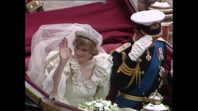 prince charles and princess diana wave and salute as their coach departs st paul's cathedral on the day of their wedding; 1981. - symbol stock videos & royalty-free footage