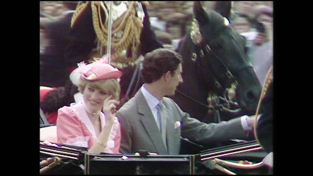 prince charles and princess diana wave at crowds as they depart buckingham palace in a horse drawn carriage for their honeymoon on the day of their... - hooved animal stock videos & royalty-free footage