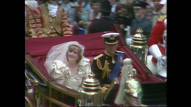 prince charles and princess diana wave from the coach as they travel down the strand on their way to buckingham palace on the day of their wedding;... - symbol stock videos & royalty-free footage