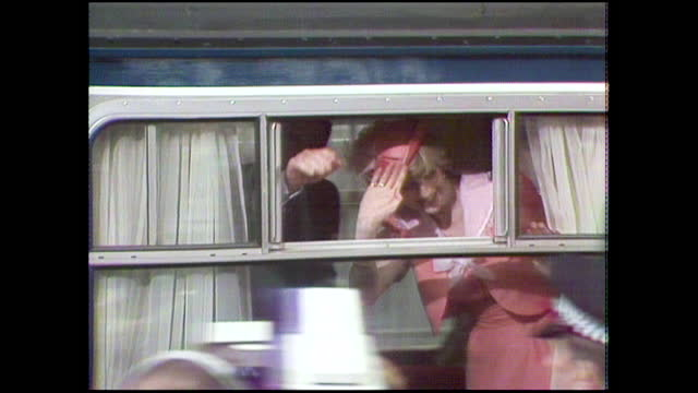 prince charles and princess diana wave from the window of the british royal train as it departs waterloo station to take them to broadlands to start... - celebratory event stock videos & royalty-free footage