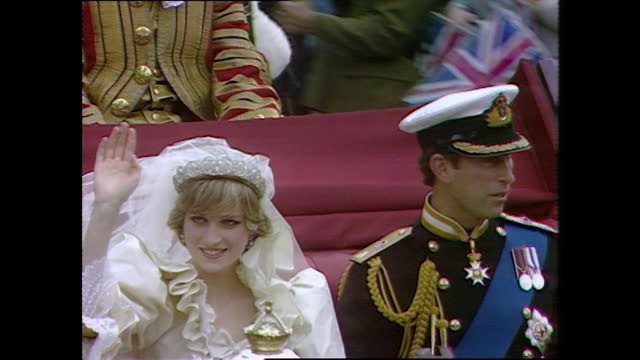 prince charles and princess diana wave to cheering crowds as they pass by on the day of their wedding; 1981. - symbol stock videos & royalty-free footage