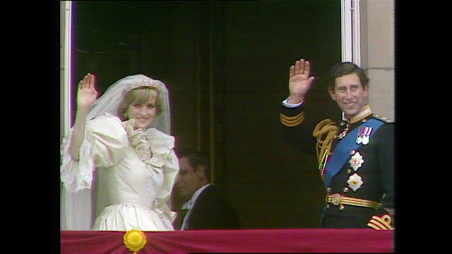 prince charles and princess diana wave to cheering crowds from the buckingham palace balcony before turning around and going inside on the day of the... - turning stock videos & royalty-free footage