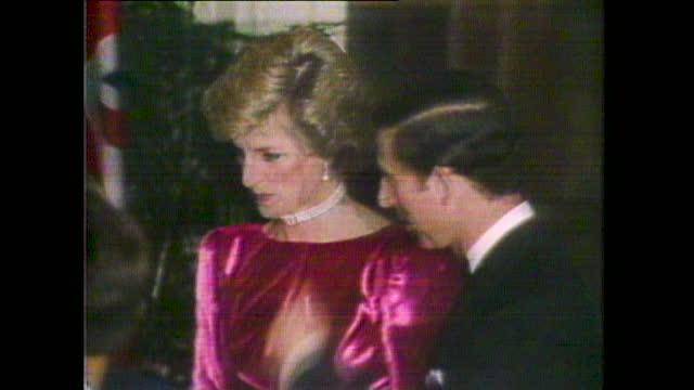 prince charles and princess diana, wearing a pink velvet evening gown, arrive at a charity ball in aid of international education during their tour... - gulf coast states stock videos & royalty-free footage