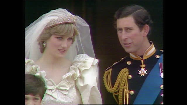 prince charles and princess diana with their page boys and bridesmaids on the buckingham palace balcony on the day of the royal wedding; 1981. - males stock videos & royalty-free footage