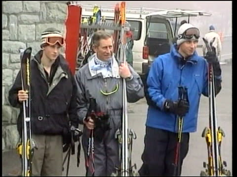 klosters skiing holiday nn u switzerland klosters ext prince charles standing with prince william and prince harry for photocall pan prince william... - vacanza sulla neve video stock e b–roll